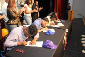 MHS football players sign their letters of intent to play college ball.