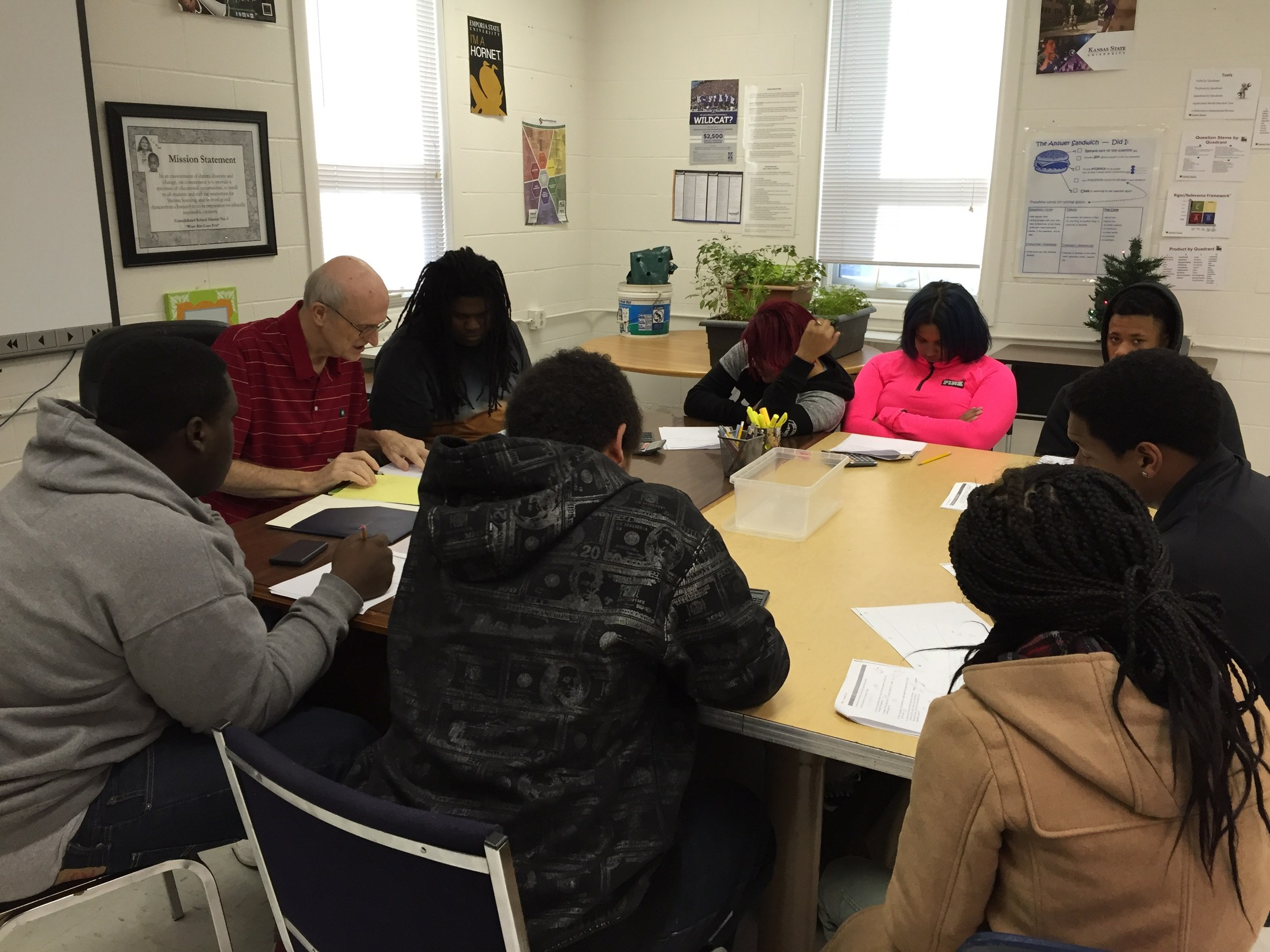 Group of students working with tutor Mr. Stewart