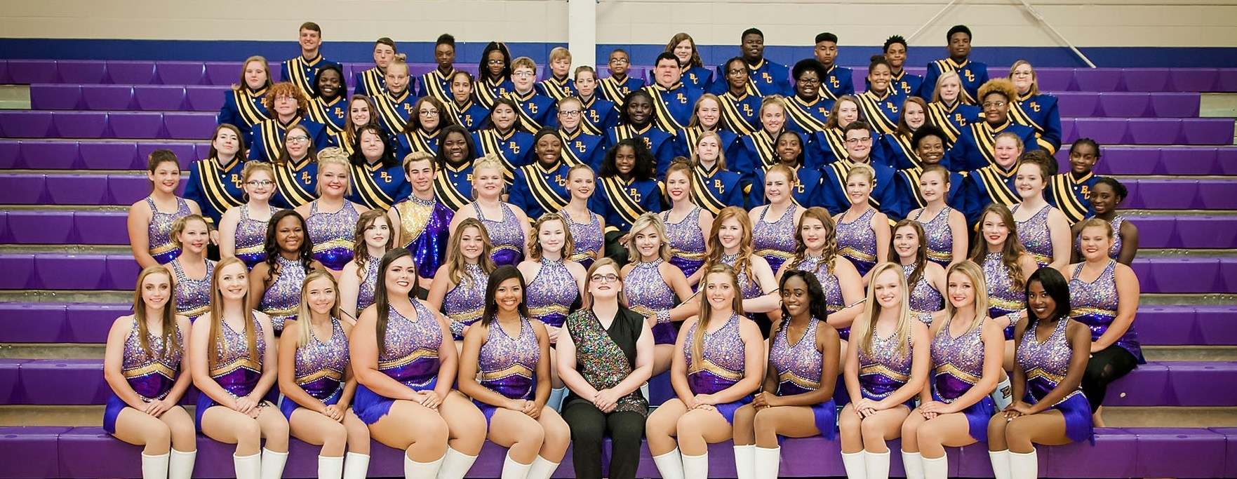 Bibb County High School Purple Pride Marching Band dressed out on bleachers