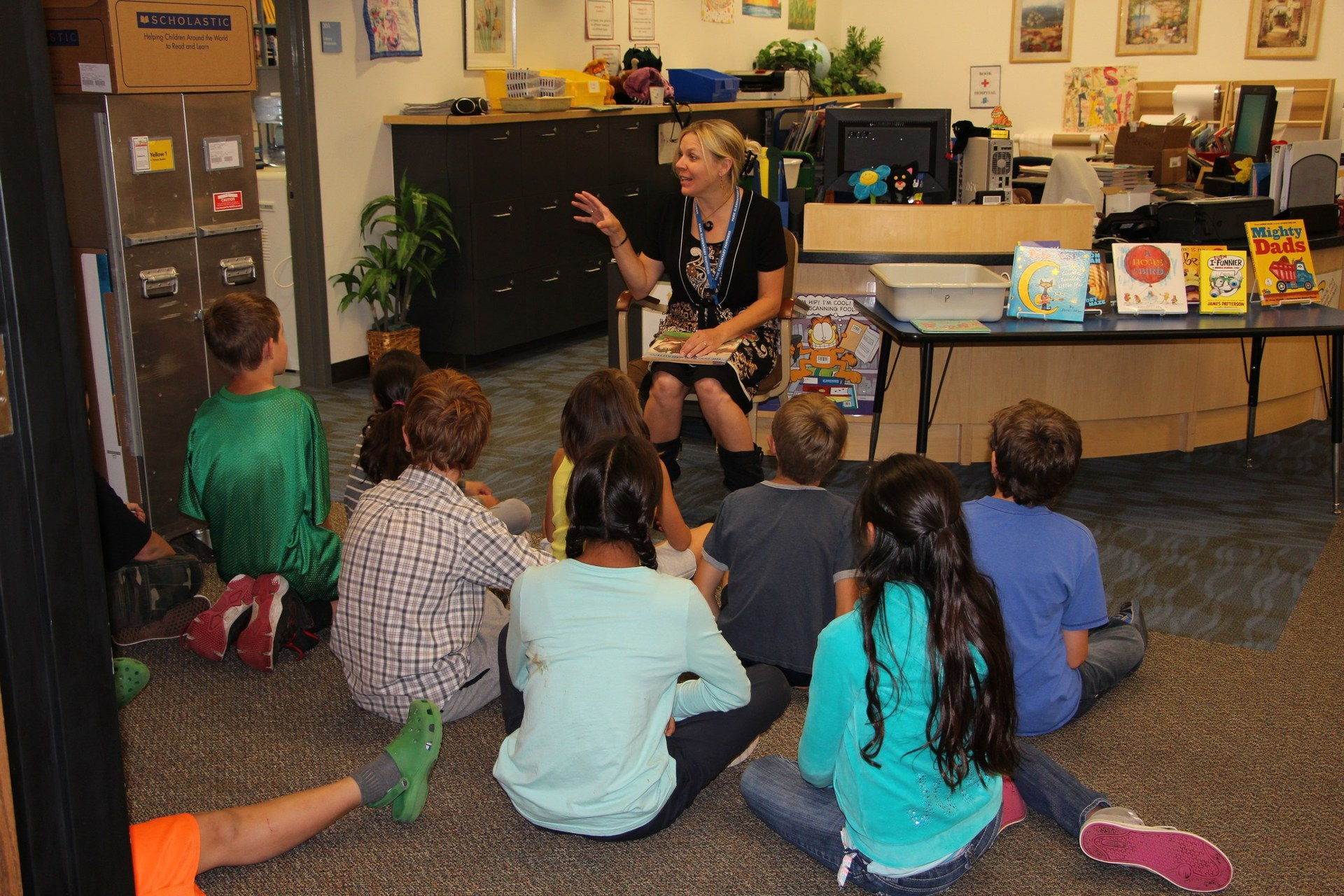 Students listen to a story in the library.