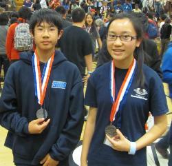 Chris and Ayesha medals.jpg