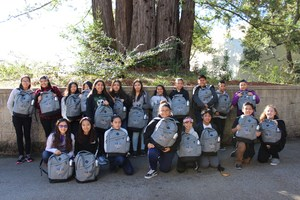 Students from Bridges Academy with their backpacks in front of trees at  UCSC