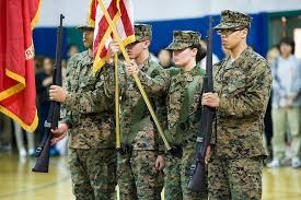 ROTC students performing a flag ceremony