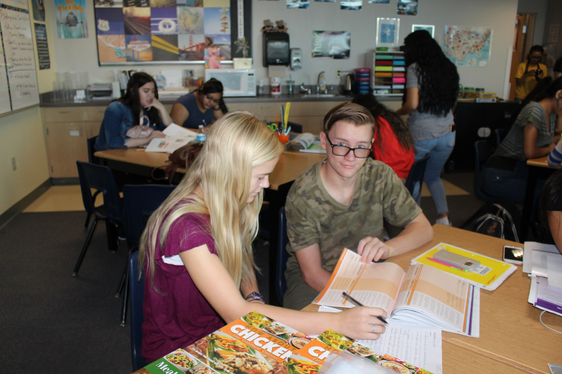 Two students working on the assignment