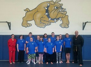 The class poses for a picture with Master Scott and Miss Tera.