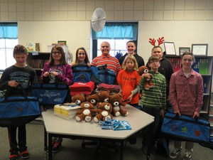 TKMS special needs students and their Links partners decorate and fill duffel bags for foster children.