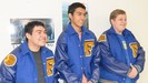 Three Special Olympians wearing their letter jackets.