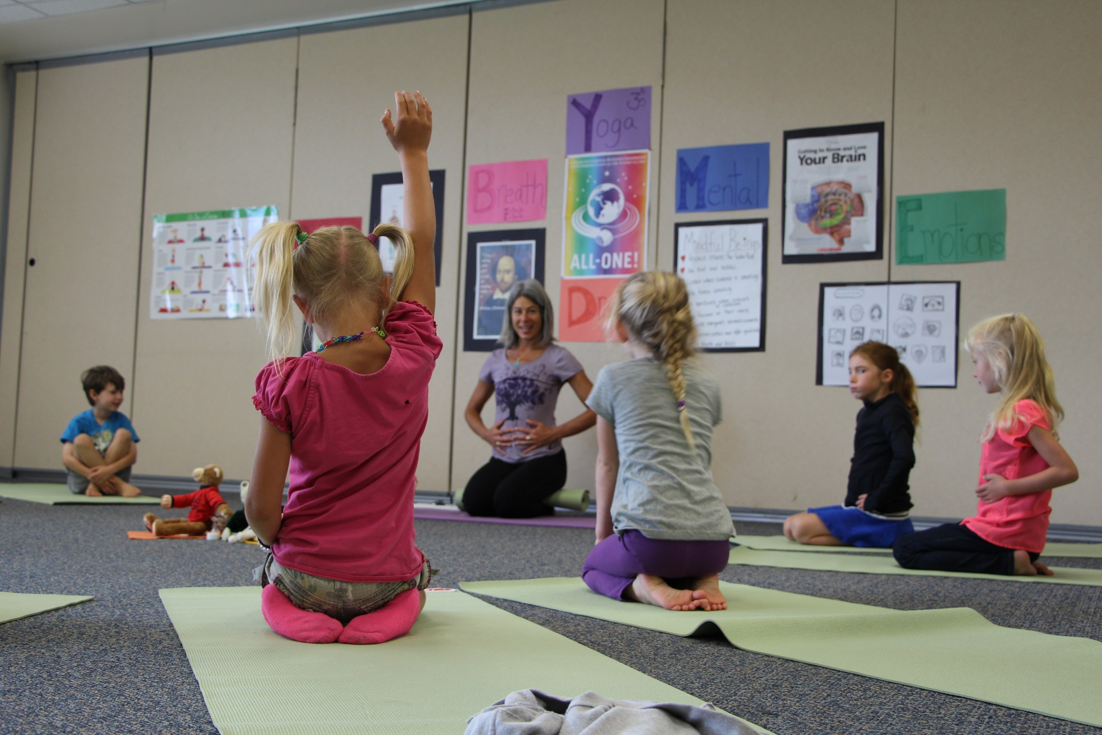 Students participate in yoga class at Shared School.