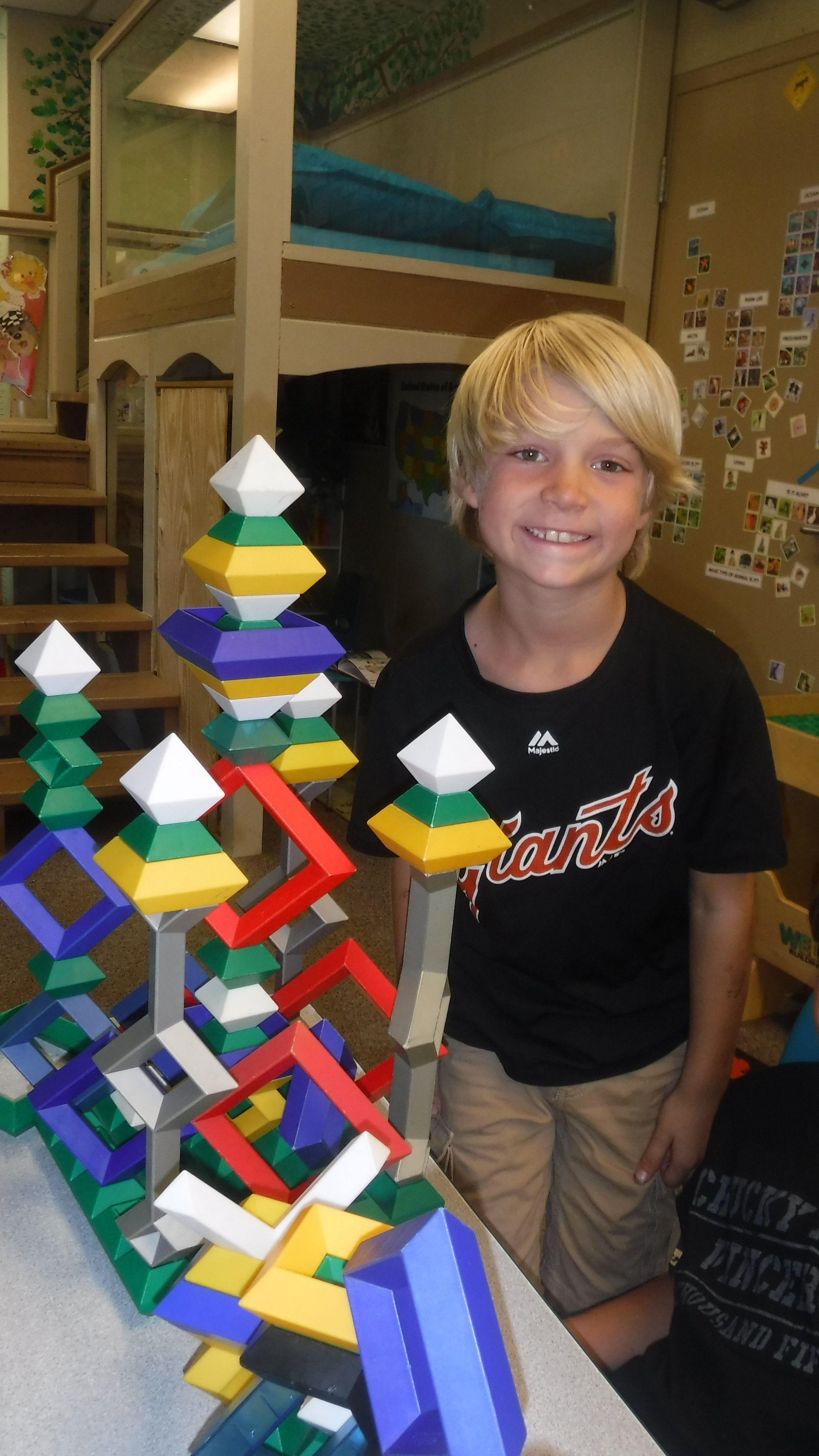 Students stacking toys