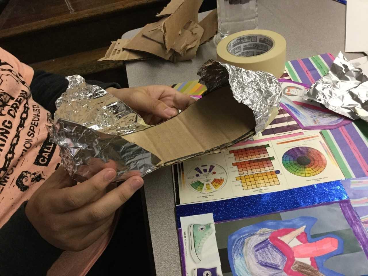 Student making sculpture.