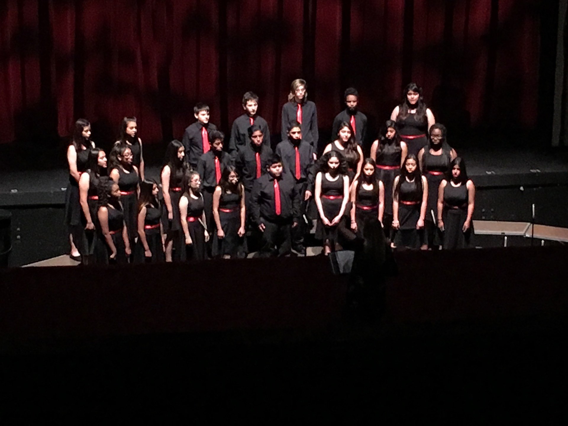 A Jr. High Choir singing.