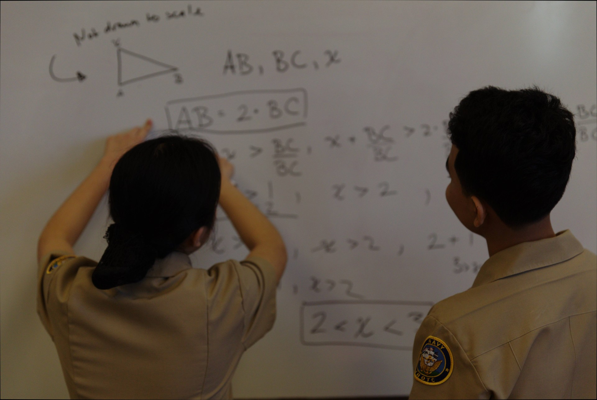 Cadet use whiteboard in math class