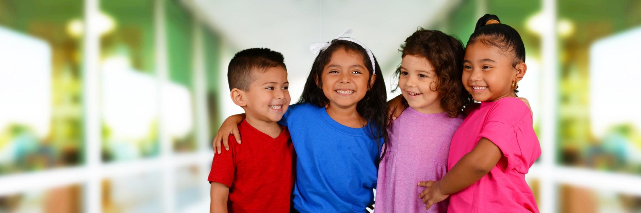 Children standing shoulder to shoulder