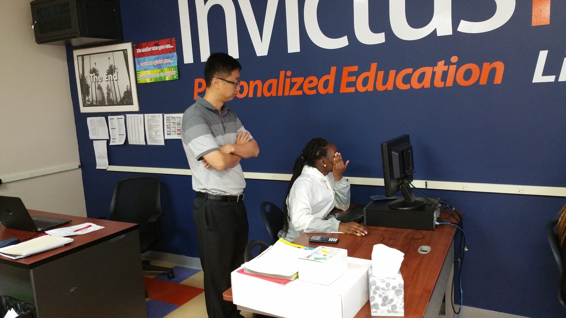 Invictus High School teacher helps student with assignment