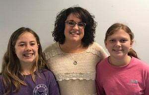 Mrs. Tywater with Student Reporters