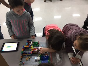 Students participating in the Jr. Lego League night.