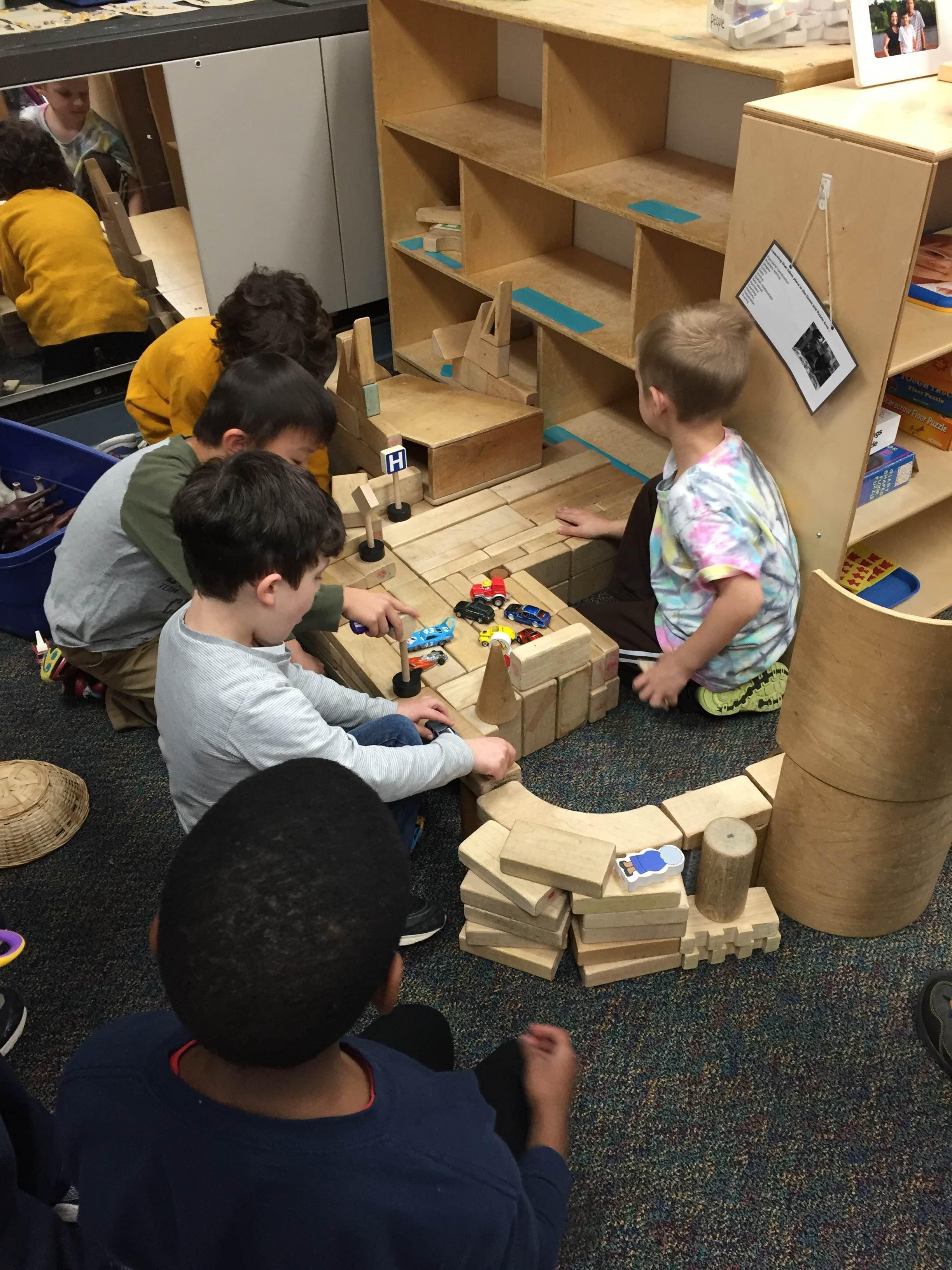 Boys building with blocks.