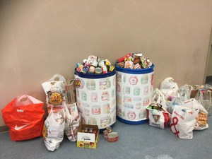 Salvation Army bins full of food donated from students and staff