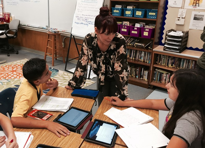 Classroom, Teacher Helping Students that are using iPads