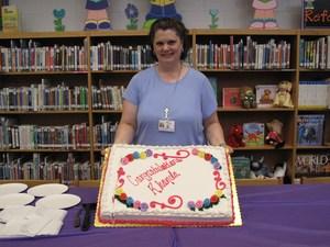 Rhonda Pena holding a cake