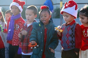 First grade students singing holiday songs.