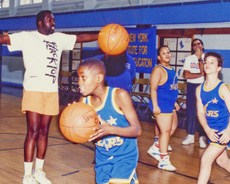 NY Knick Earl Monroe putting the Van Cleve basketball team through some drills.