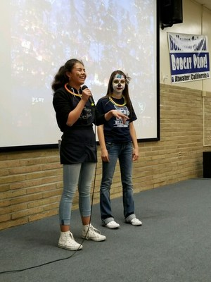 2 girls standing to give announcements