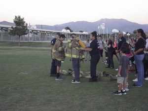 Student dressed in firemen gear during the Health and Fitness Fair
