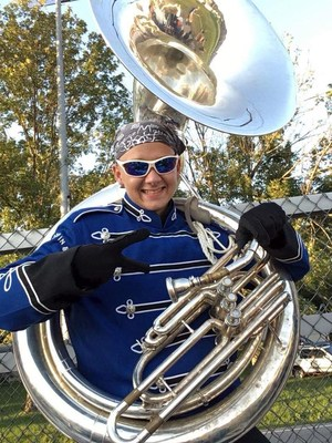 Picture of Ethaniel with a tuba