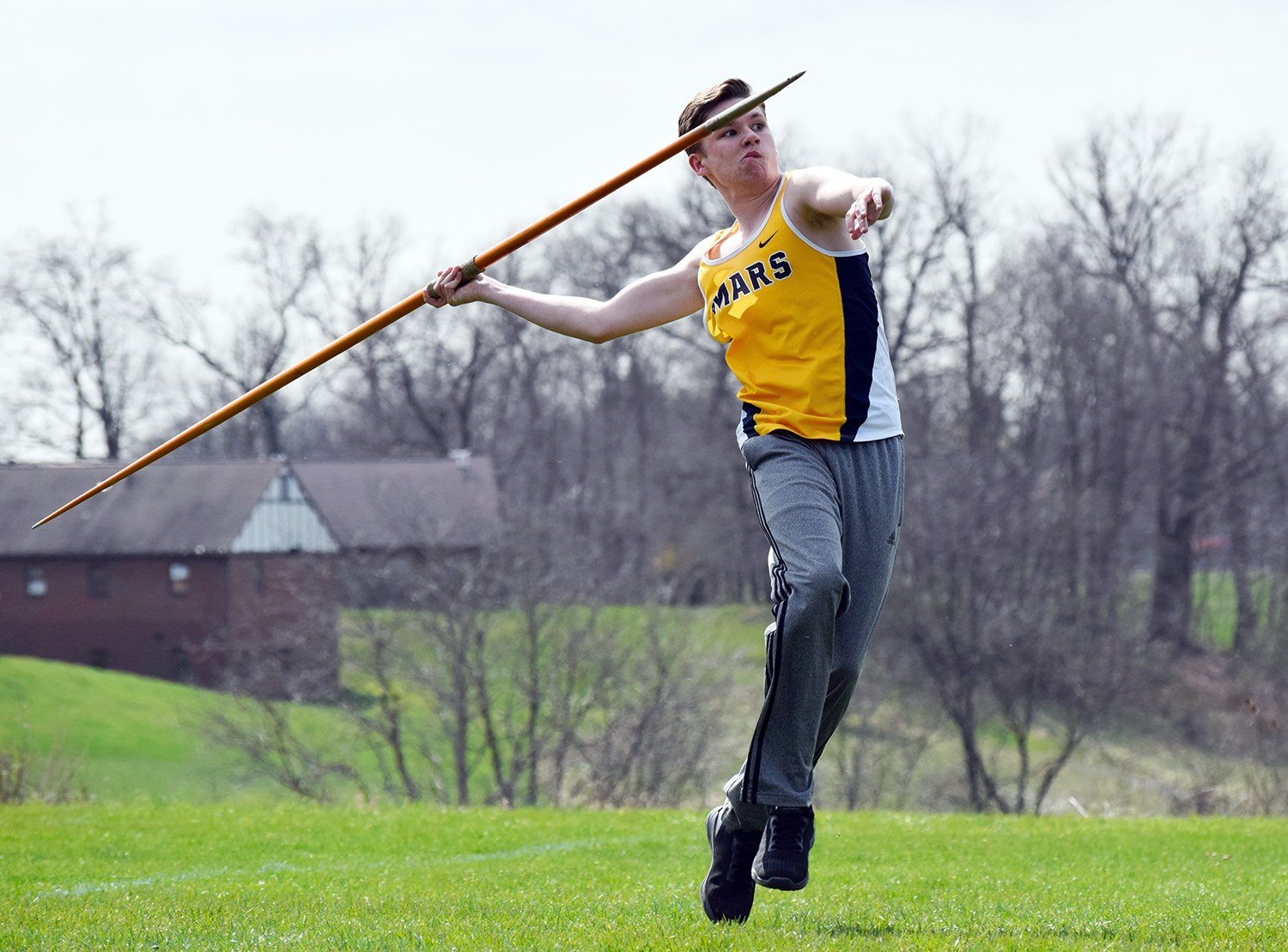boy throwing javelin