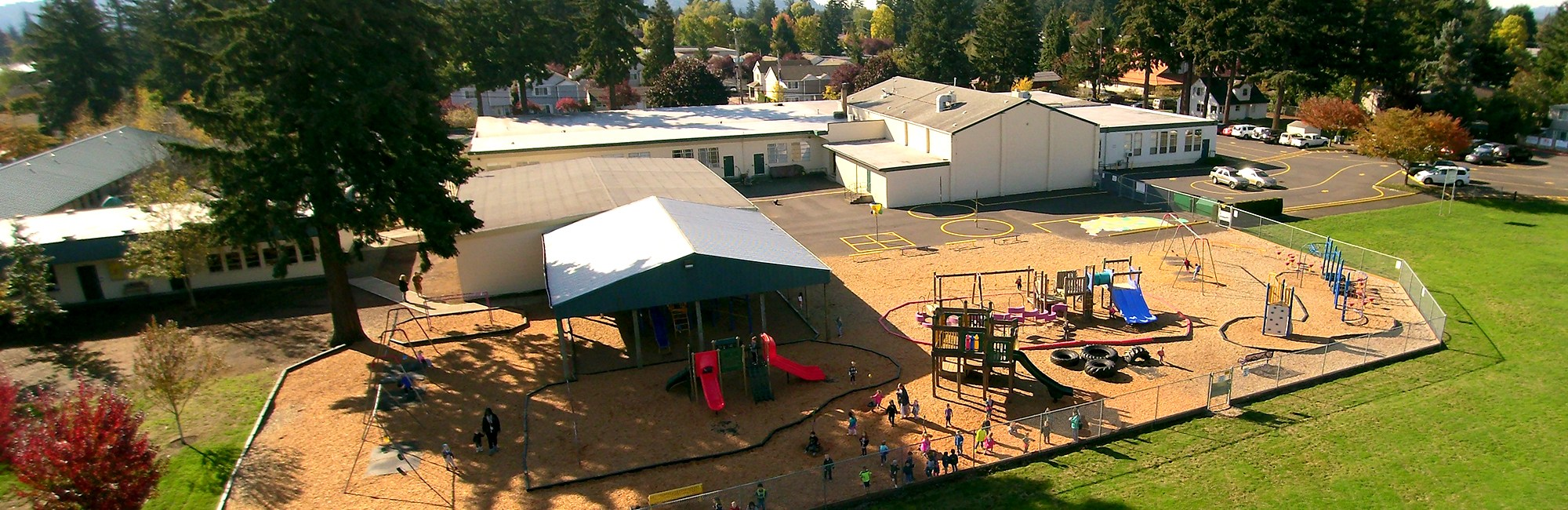 Aerial photo of Elementary campus with playgrounds in foreground
