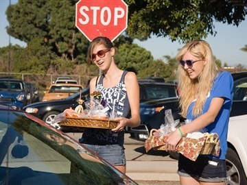 PVHS AVID offer treats for sale at car wash