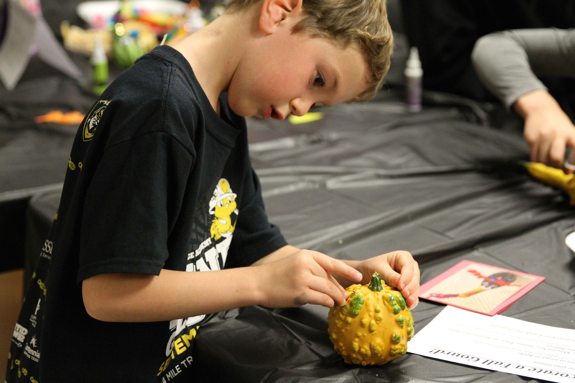 student decorating gourd