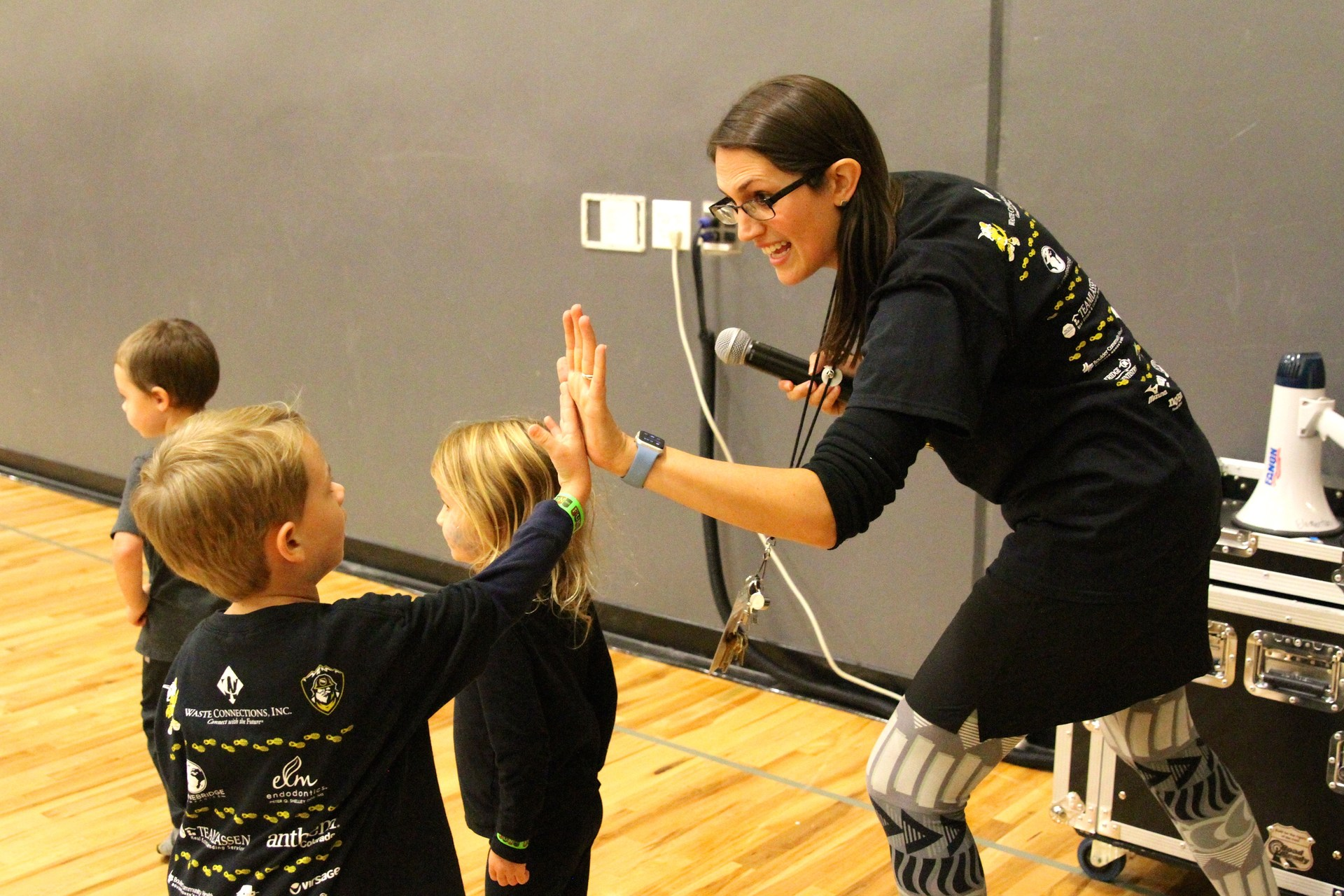 Mrs. Wilkin gives student a high five