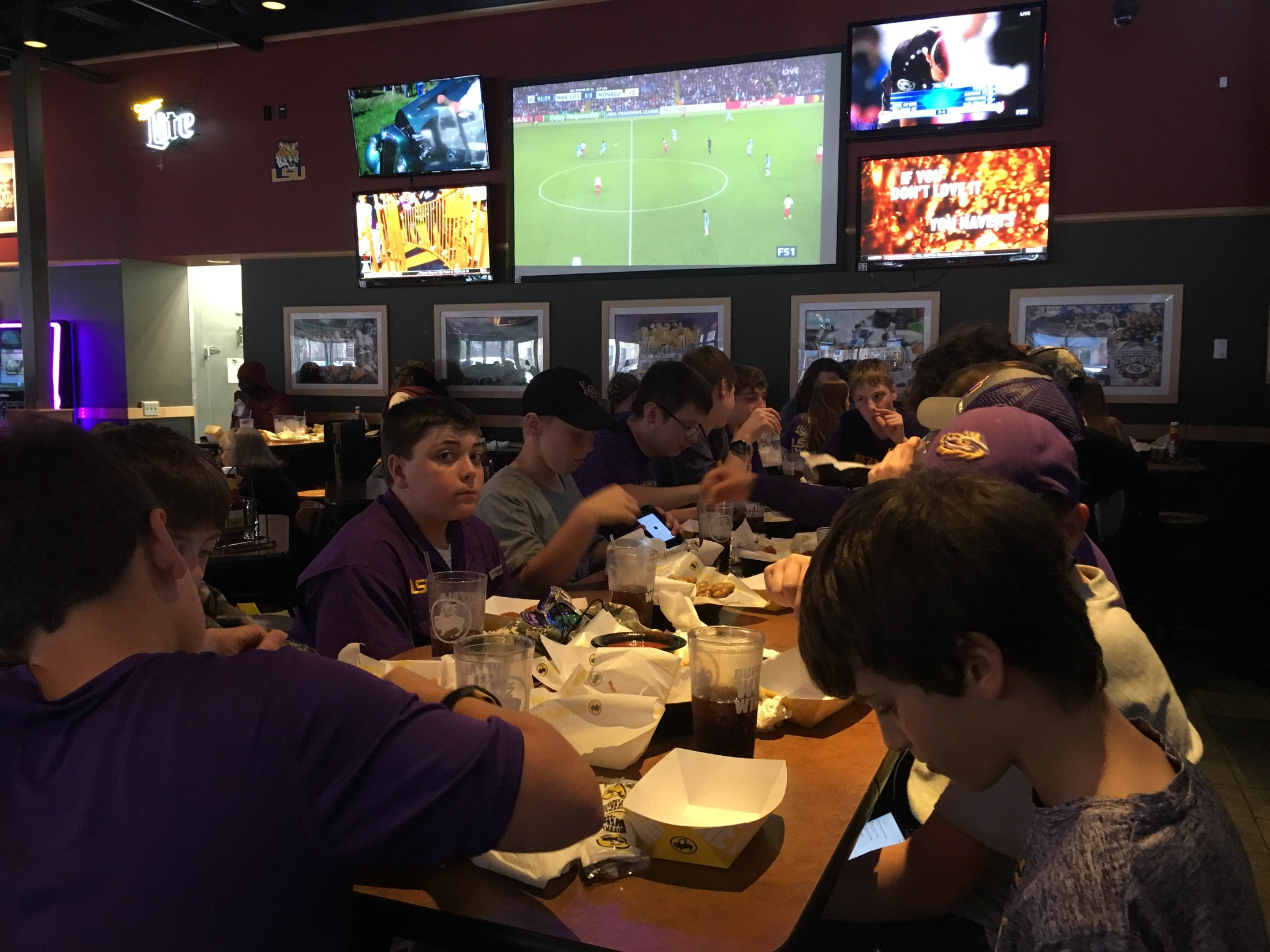 Boys eating at Buffalo Wild Wings