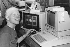 Corky at Camp Wapanacki using Apple II computer
