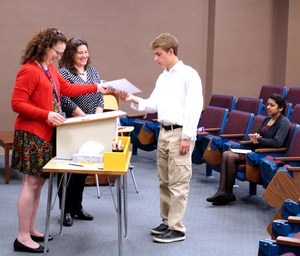 Beau  receiving her certificate from Joeal Mazurowski and Sherri James
