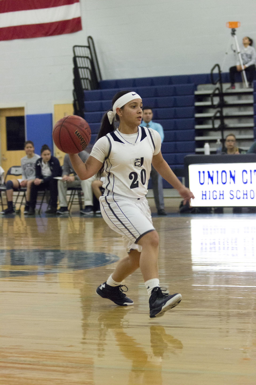 girl passing basketball