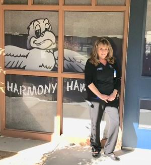 Teresa McFarland in front of a Harmony sign.