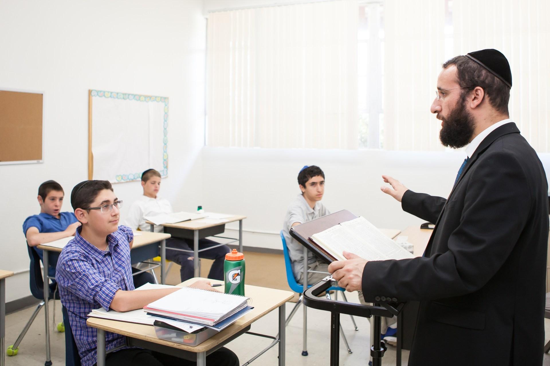 teacher teaching the middle school boys
