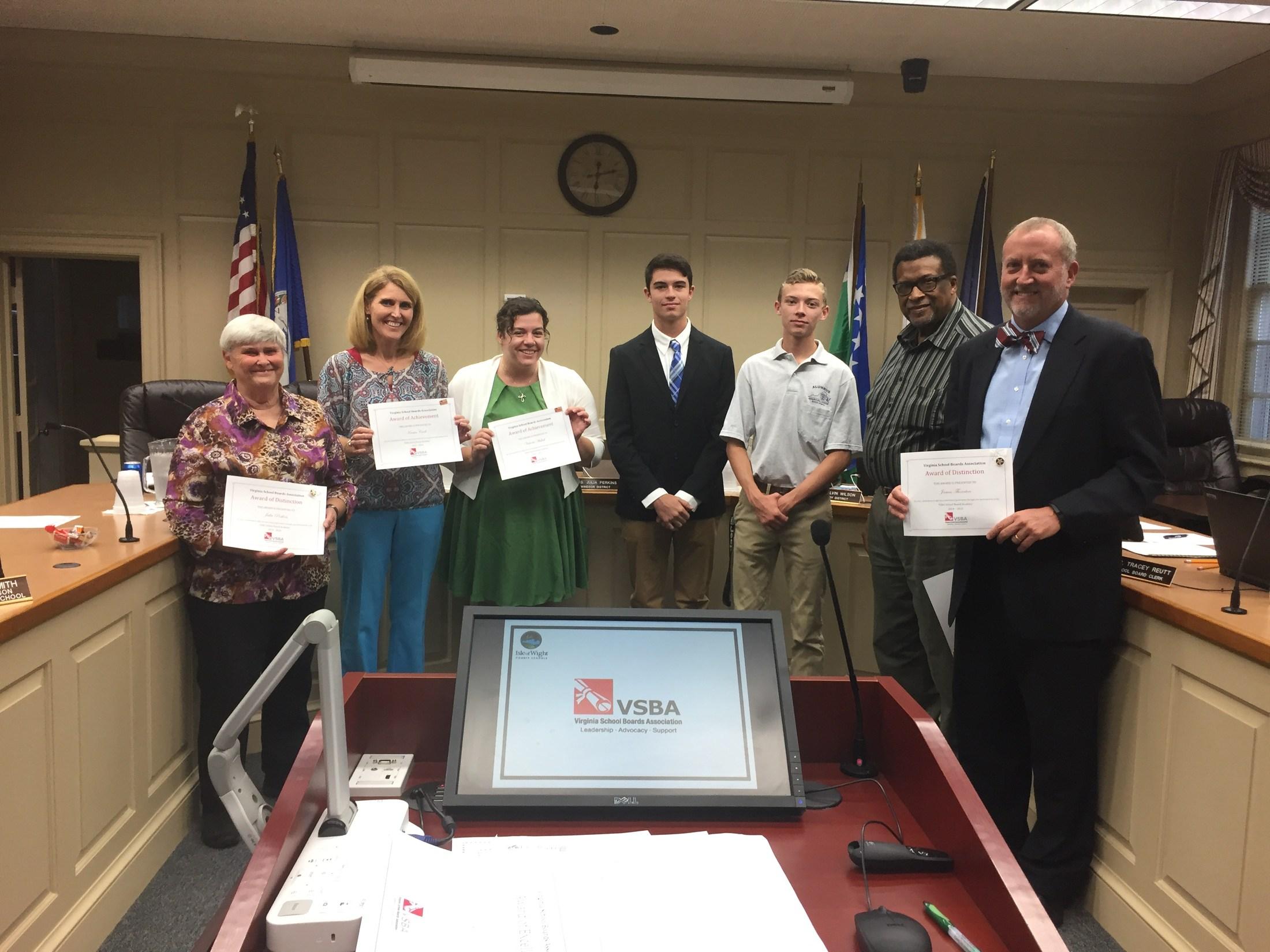 school board members holding certificates