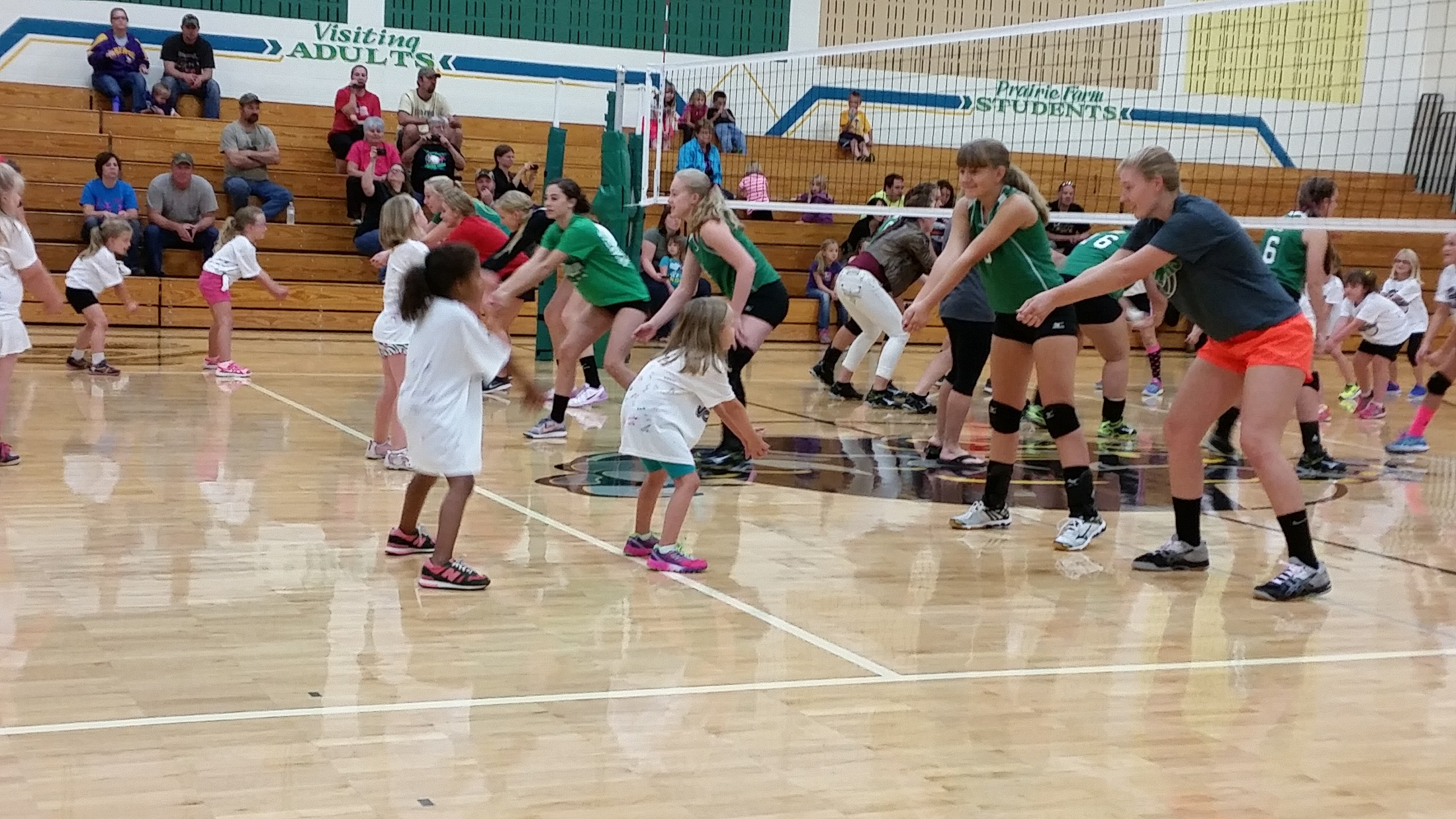 Multi-age volleyball instruction.