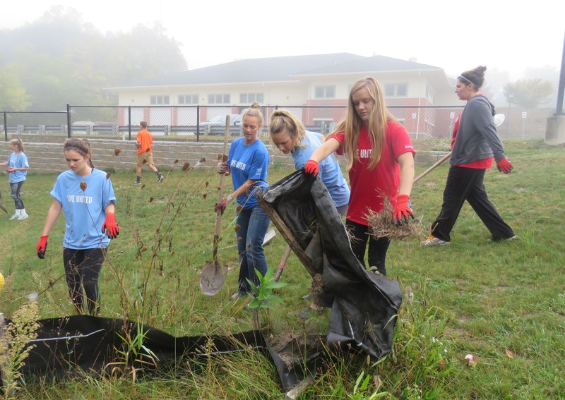TKHS Student Council members tackle clean up projects along the Paul Henry Thornapple Trail.