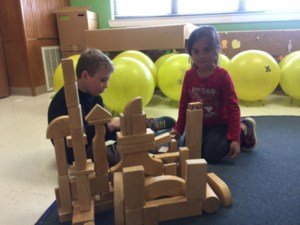 CLUB Students enjoy problem solving as they build with blocks together.
