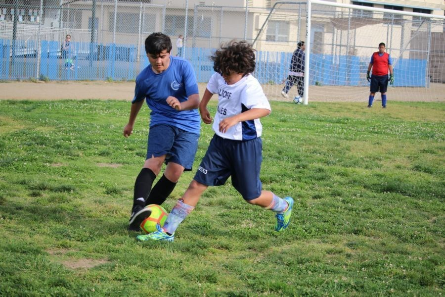 Soccer dribbling boys
