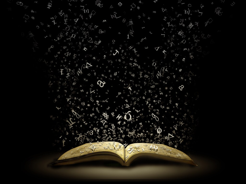 Words falling into an open book.
