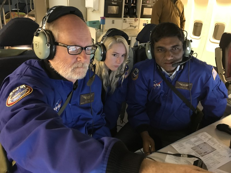 Tom Gavin, Judy Jennings and Ravinder Athwal study the raw data coming from the infrared telescope on board NASA's SOFIA mission