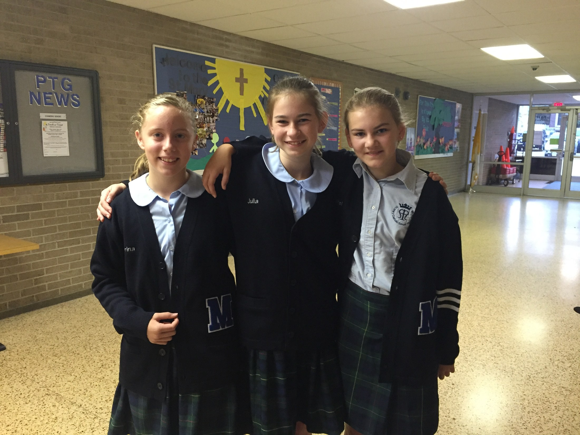 The letter sweaters look great! St. Mary Catholic School