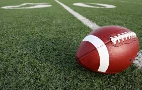 Image of a football on the turf. This is being used to illustrate an upcoming banquet for the football team.