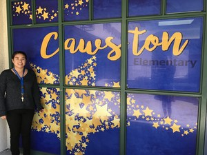 Paulette Zetina in front of a Cawston sign.